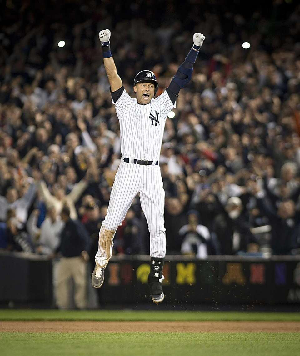 New York Yankees' Derek Jeter jumps for joy