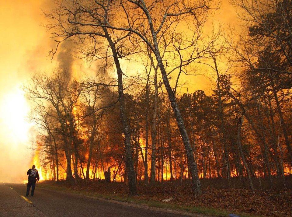 Firefighters battle a large brush fire in Ridge