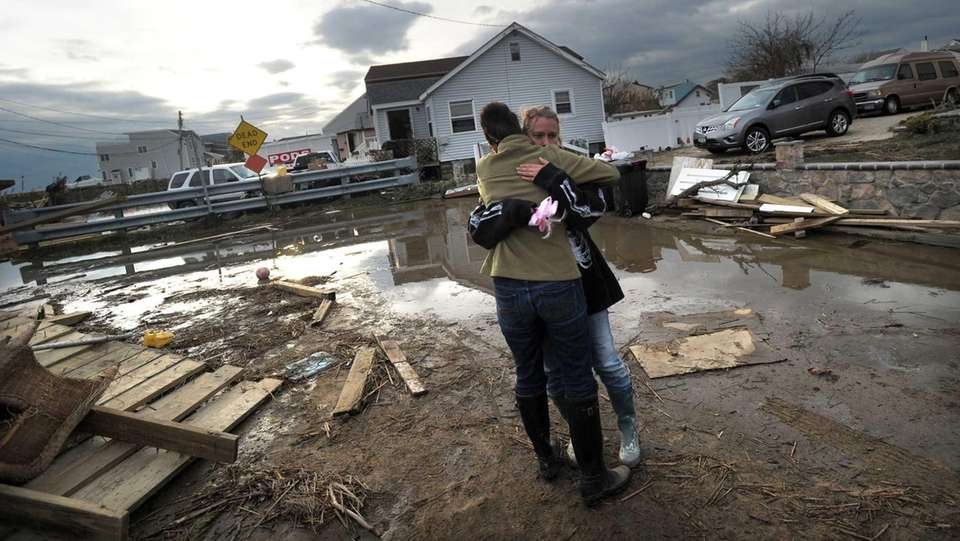 Lisa Beardsley, right, hugs her neighbor Pamela Danziger
