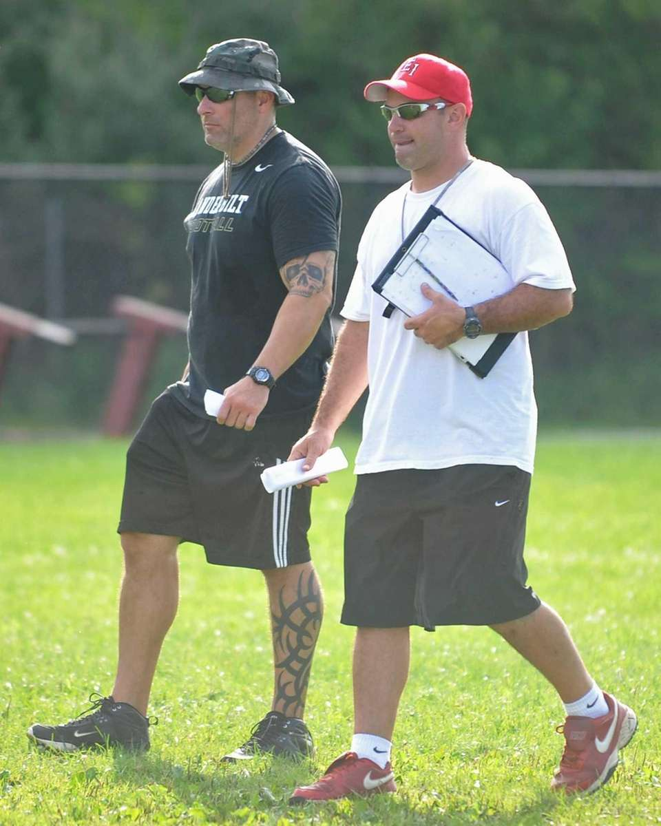 East Islip assistant coaches Mike Gentile, left, and