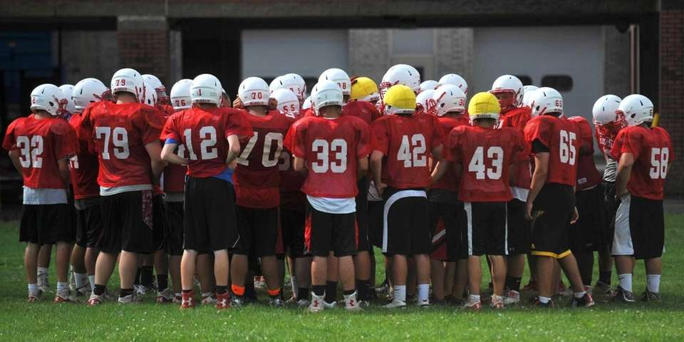 East Islip teammates huddle together at the end