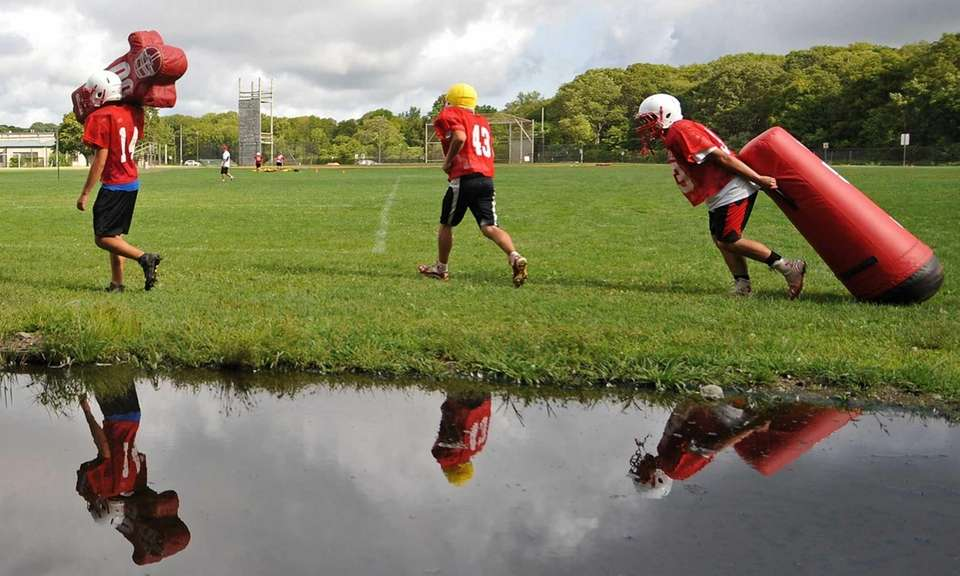East Islip's Devin Rigby, left, leads a convoy