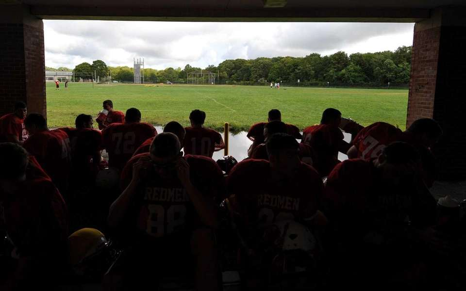East Islip teammates cool off in the shade