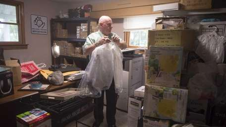 Timothy Jaccard sorts through supplies at the safe