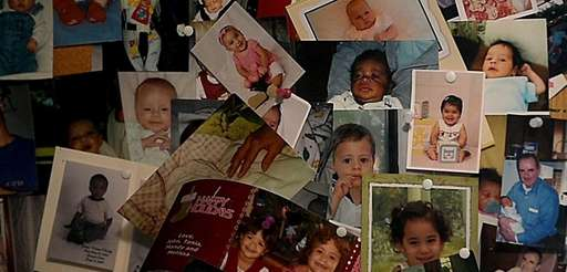 A collage of baby photos hangs in the