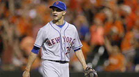 New York Mets relief pitcher Carlos Torres walks