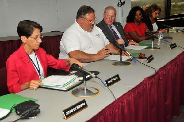 From left: Nassau Community College trustees Kathy Weiss,