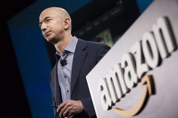 Amazon.com founder and CEO Jeff Bezos presents the