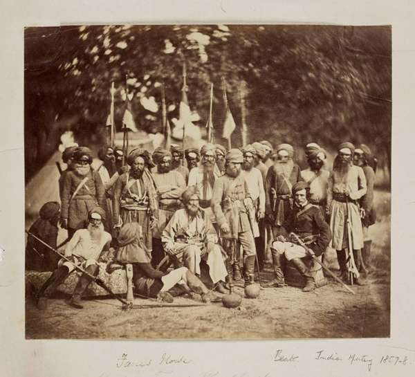 Two European officers, surrounded by Indian soldiers mustered