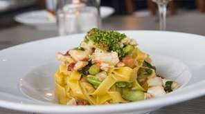 Housemade tagliatelle with lobster and asparagus is served