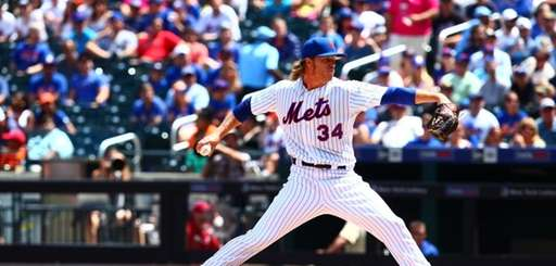Mets starter Noah Syndergaard delivers a pitch in