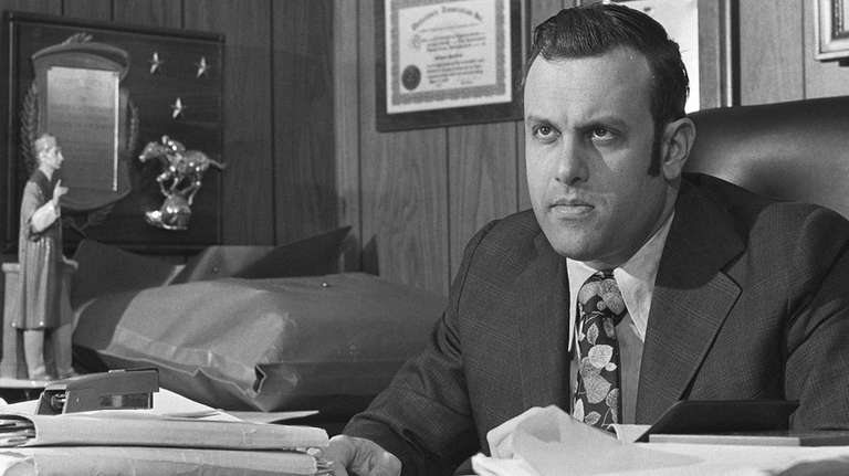Richard Hartman, pictured in his office in Mineola
