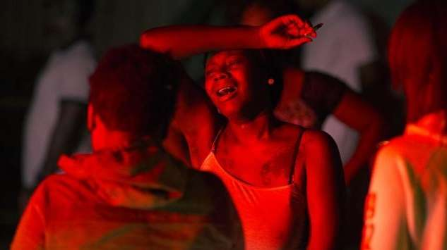 A young woman cries at the scene of