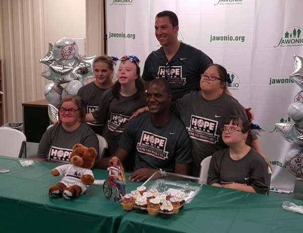 Yankees pitcher Michael Pineda sits with members of