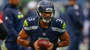 Quarterback Russell Wilson of the Seattle Seahawks warms