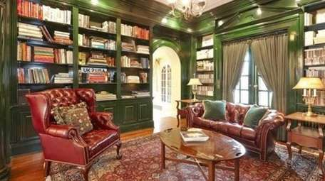 The green lacquered library in this five-bedroom Garden