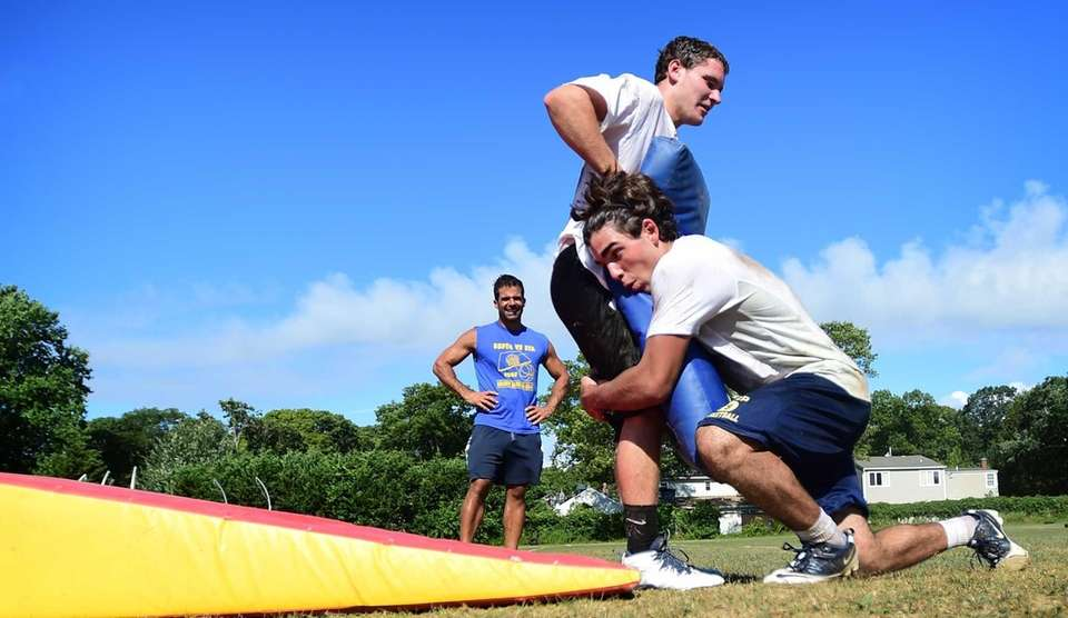 Members of the Bayport-Blue Point football team work