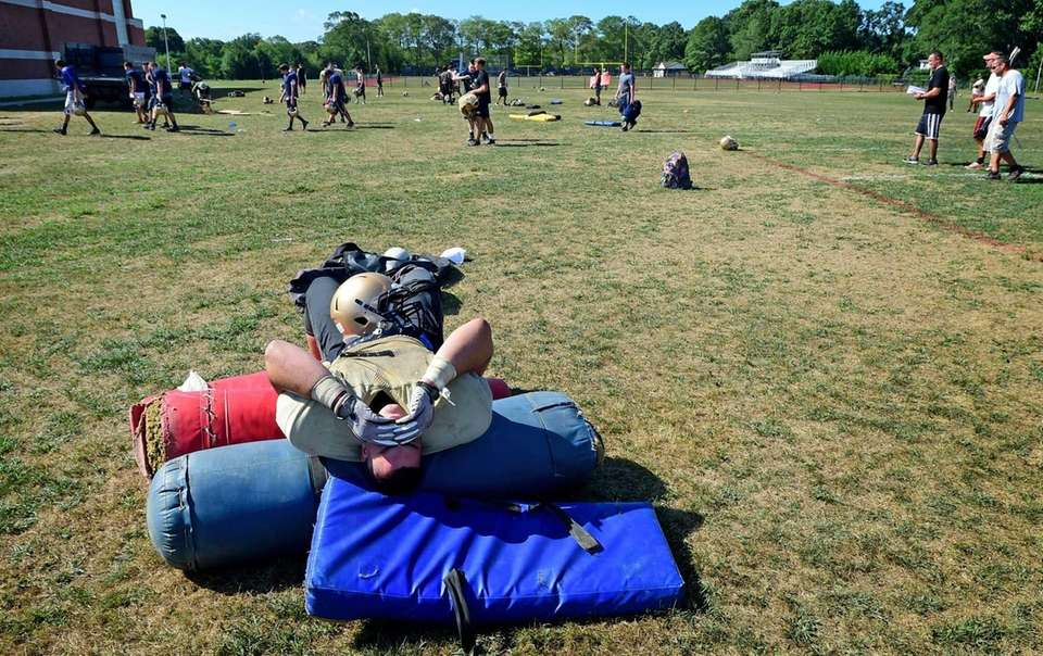 Bayport-Blue Point's Dylan Ingber rests after football practice