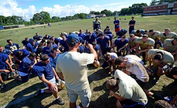 Bayport-Blue Point head coach Eric Iberger addresses the
