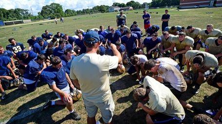 Bayport-Blue Point head coach Eric Iberger addresses the