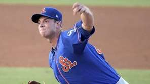 New York Mets pitcher Steven Matz throws a