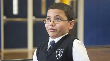 St. Ann School fourth-grader Noah Rodriguez reacts while