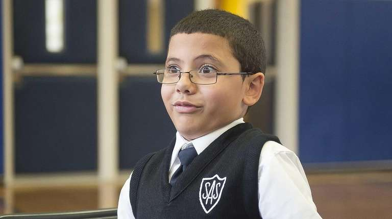 St. Ann School fourth-grader Noah Rodriguez reacts while