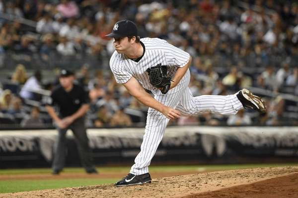 New York Yankees relief pitcher Adam Warren delivers