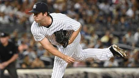 New York Yankees relief pitcher Adam Warren delivers
