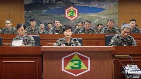 South Korean President Park Geun-hye, bottom center, presides