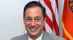 Michael Zapson is shown at his Mineola office