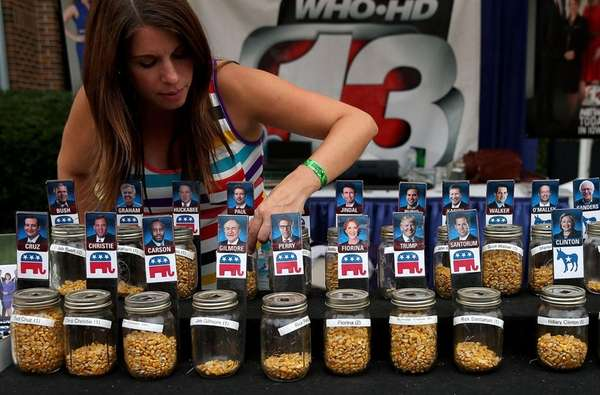 A worker adjusts jars filled with corn kernels