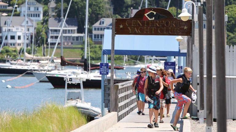 Children walk off the dock at Centerport Yacht