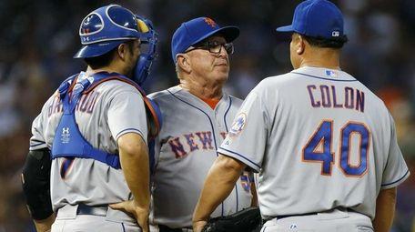 New York Mets starting pitcher Bartolo Colon confers