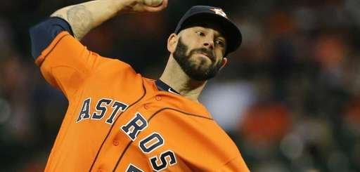 Mike Fiers of the Houston Astros throws a