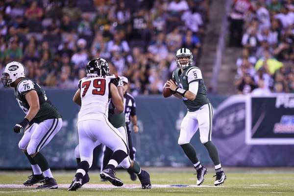 New York Jets quarterback Bryce Petty drops back