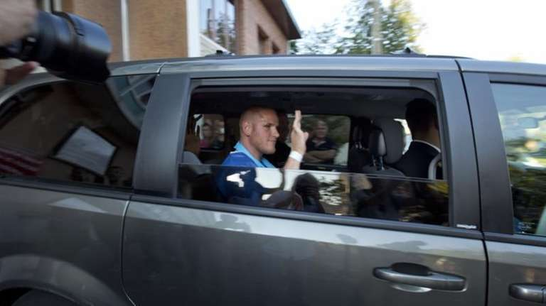 American Spencer Stone waves as he leaves the