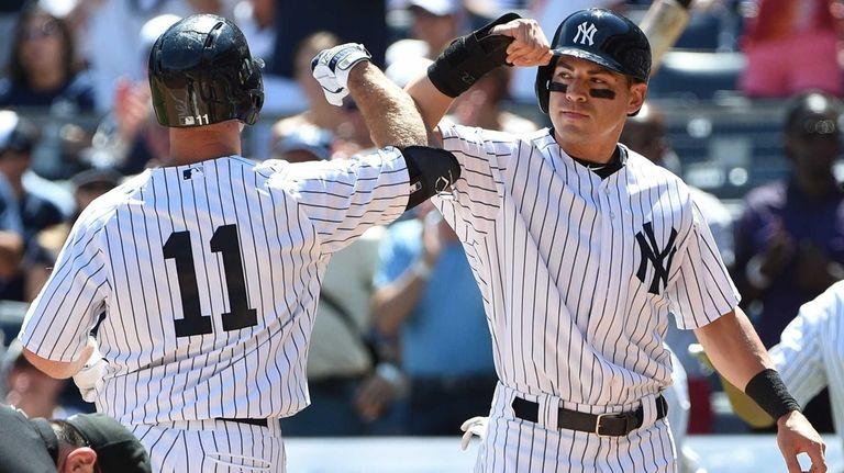 New York Yankees centerfielder Jacoby Ellsbury greets Yankees