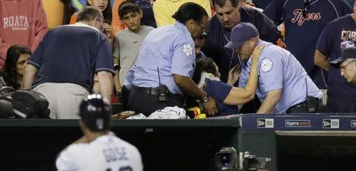 A fan is helped into a stretcher after