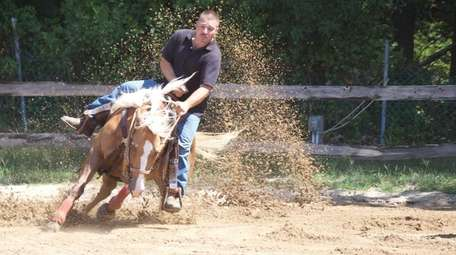 Kenneth Schwamb rides during the Open Barrel Race