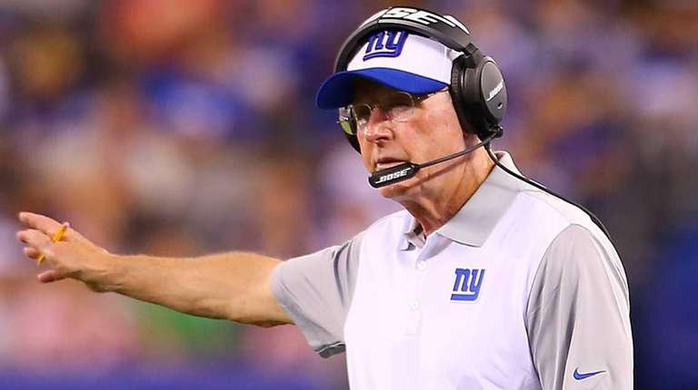 New York Giants head coach Tom Coughlin looks