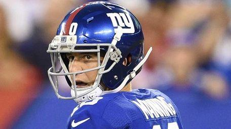 New York Giants quarterback Eli Manning steps back