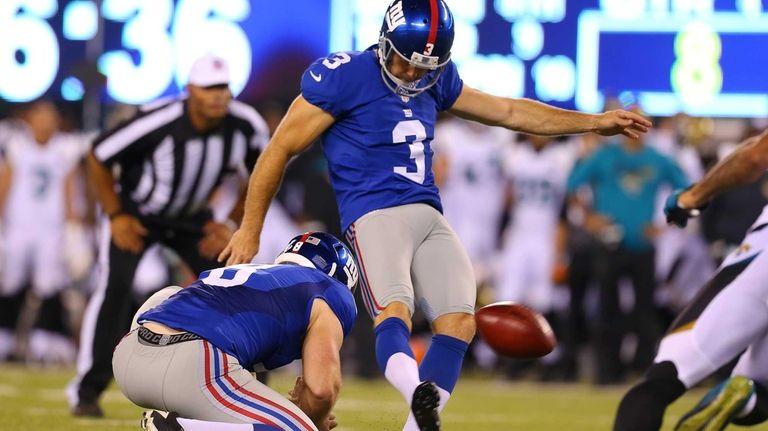 New York Giants kicker Josh Brown (3) kicks