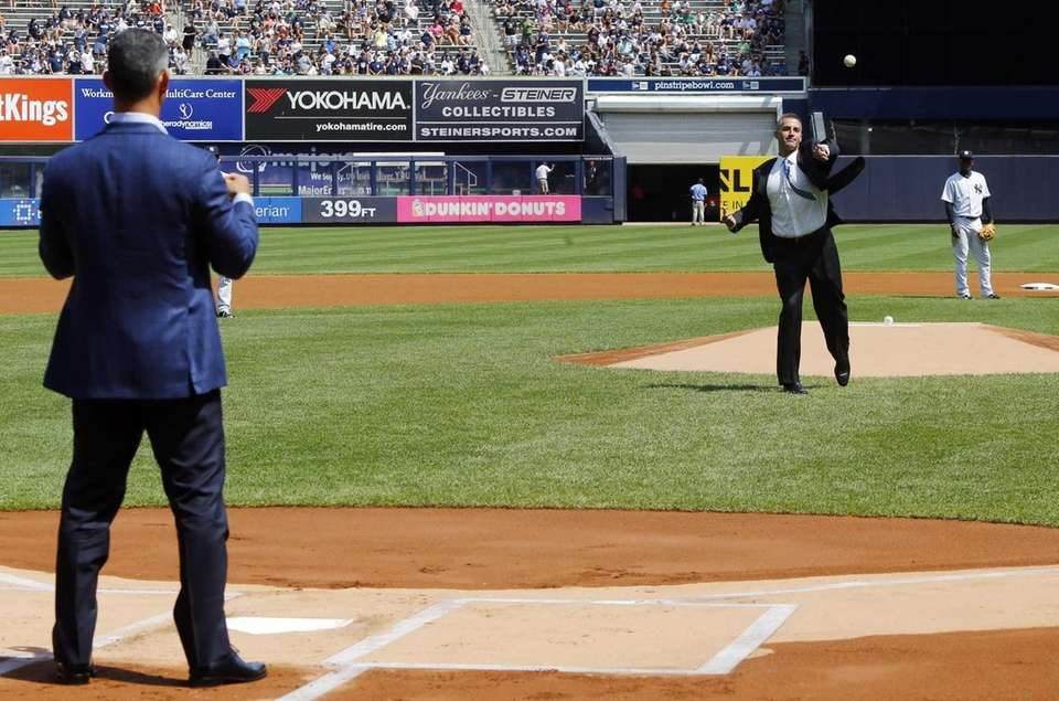 Andy Pettitte throws the ceremonial first pitch to