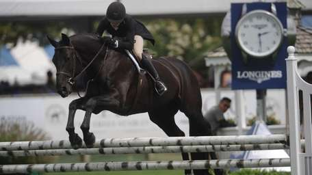Rindy Dominguez rides Eclipse over the jump course