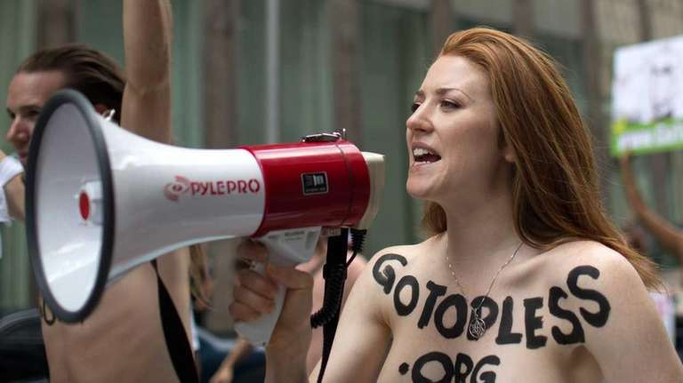 Rachel Jessee speaks into a megaphone while riding