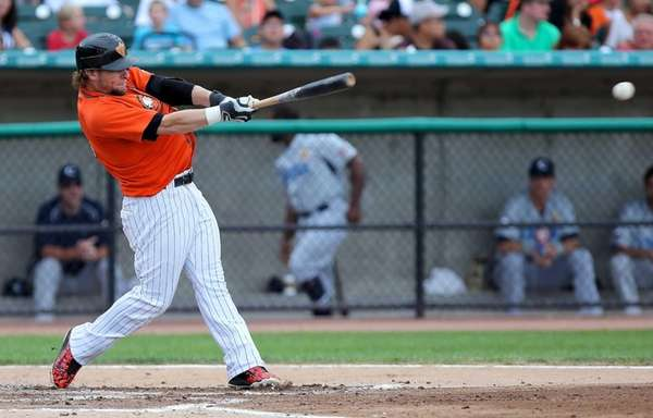 Long Island Ducks' Cody Puckett drives a single