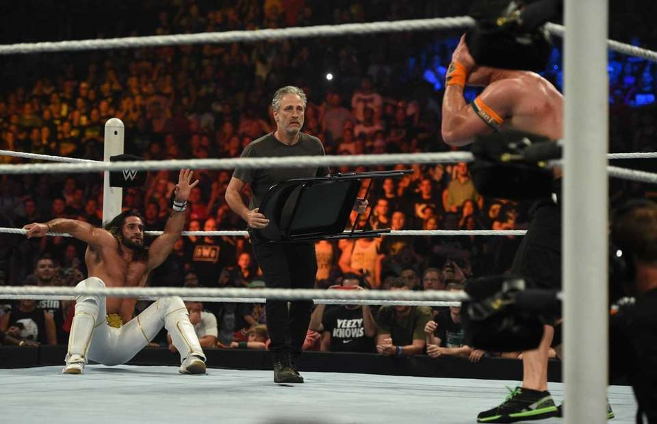 Jon Stewart enters the ring with a chair