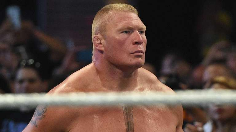 Brock Lesnar looks on from the ring before