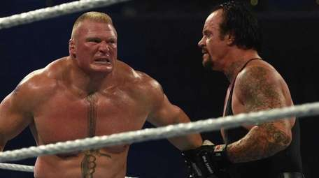 Brock Lesnar, left, and The Undertaker, wrestle during